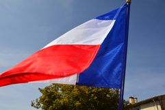 French flag in the wind on a sunny day outdoor. French flag in the wind on a sunny day stock photo