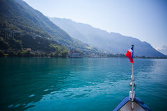 French flagged ship on mountain lake. French boat on lake Geneva close to Montreaux, Switzerland facing the french side of the lake. Alps in the background stock image