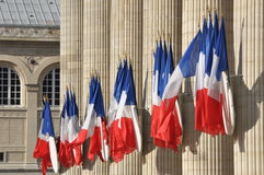 French flags in front of Pantheon. Row of French flags hanging from columns of Pantheon in Paris royalty free stock photos