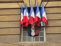 French Flags at a Window. Five French tricolor flags are flown from a window in Paris Royalty Free Stock Photography