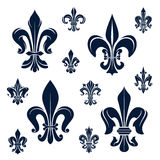 French fleur-de-lis heraldic symbols and flowers Royalty Free Stock Photography