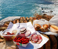French food picnic outdoors near sea. With market food on the old brick wall Stock Images