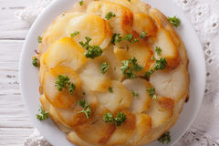French food: Potato gratin on white plate closeup. horizontal to Stock Images