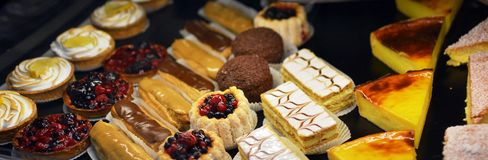 French Food For Sale at Antibes Market, Provence France. Including sweet pastry tarts, eclairs, slices and pies Royalty Free Stock Photos