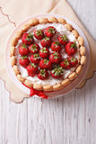 French Fresh Strawberry charlotte cake. vertical top view. French Fresh Strawberry charlotte cake on a table. vertical top view Stock Photos