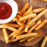 French fried and ketchup. On board Stock Image