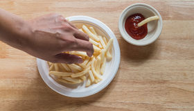 French fried and ketchup. Pick french fried and dip ketchup Royalty Free Stock Photography