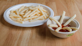 French fried and ketchup. On wooden table Royalty Free Stock Image