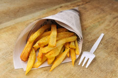 French fried potatoes and fork Royalty Free Stock Photos
