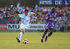 French friendly soccer match OM vs TFC. Olympique de Marseille's Karim Ziani and Toulouse's Achille Emana during the french friendly soccer match, Olympique de Stock Photo
