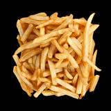 French Fries. A Batch of French Fries Isolated on a Black Background royalty free stock image