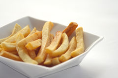French fries. In white plate on white background Stock Photo