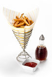 French Fries. With malt vinegar, and ketchup sides on white background Royalty Free Stock Photography