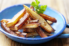 French fries. Homemade french fries, made from hand cut potatoes Stock Images