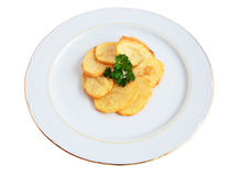 French fries. Plate of chips with a sprig of parsley cut and isolated Royalty Free Stock Images