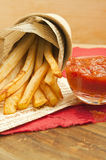 French fries. And dipping sauce on a table Stock Photos