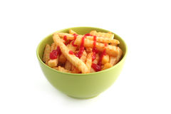 French fries. Bowl of french fries with ketchup isolated on white royalty free stock photography