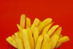 French fries. On red background, space for messages Royalty Free Stock Photos