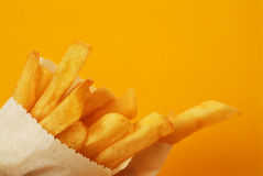 French Fries. On a Orange Background Royalty Free Stock Images