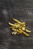 French fries air fried outside dish on black worn table royalty free stock photography