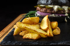 French fries in the background hamburger. Stock Photos