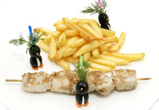 French fries and barbecue Royalty Free Stock Image