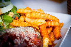 French fries on BBQ rips plate Royalty Free Stock Photography