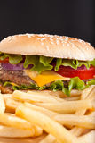 French fries and big cheeseburger Royalty Free Stock Photos