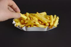 That`s yummie but fattening. French fries on black background stock images