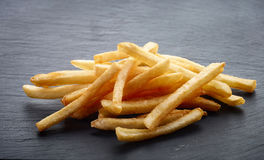 French fries on black stone background Royalty Free Stock Photo