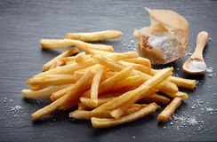 French fries on black stone background Stock Photos