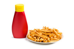 French fries with bottle of ketchup Royalty Free Stock Photos