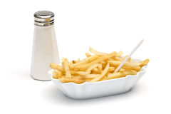 French fries in bowl and salt shaker Royalty Free Stock Photography