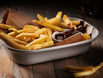 French fries. In a bowl on a wooden background Royalty Free Stock Photos