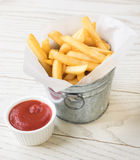 French fries. In bucket with ketchup Stock Photo