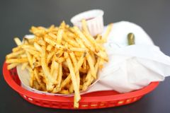 French fries and a burger Royalty Free Stock Photo