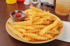 French fries and catsup Royalty Free Stock Photos