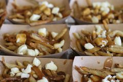 French fries with cheese curds in small boxes stock photography