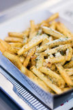 French fries with cheese. On table Stock Photo