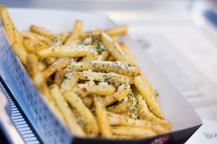 French fries with cheese. On table Stock Image