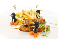 French fries and chicken kebabs Stock Photo