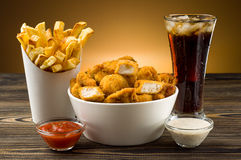 French fries chicken nuggets and cola Royalty Free Stock Photography