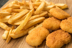 French fries and chicken nuggets Royalty Free Stock Photography