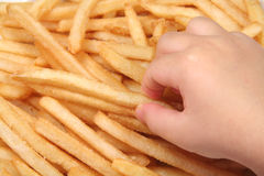 French fries and child hand. Child hold french fries royalty free stock photos