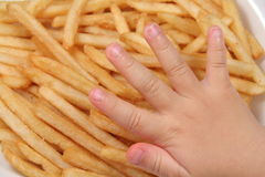 French fries and child hand.  royalty free stock images