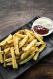 French fries chips with diping sauces on wooden table Stock Photography