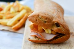 French fries and Ciabatta bread sandwich stock photography