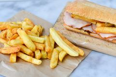 French fries and Ciabatta bread sandwich stock photos