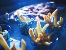 French fries, in clear blue cups in the morning sun. royalty free stock photo