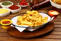 French fries. Crunchy French Fries with sauces in basket Stock Photos